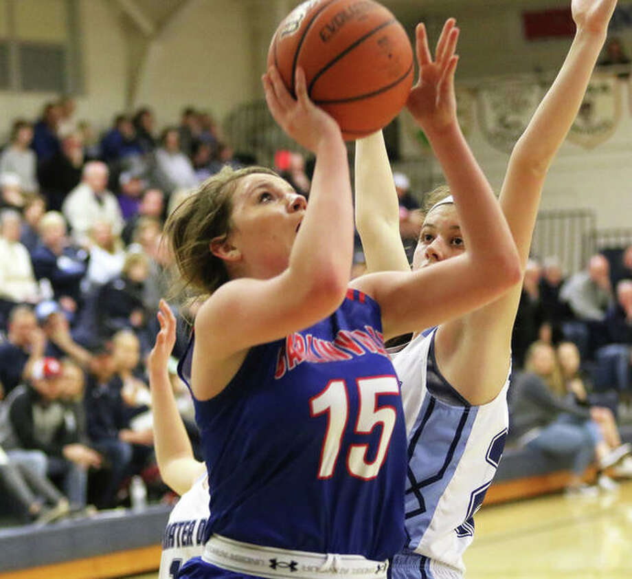 Carlinville's Gracie Reels (15), shown scoring in last season's Greenville Class 2A Sectional loss to Breese Mater Dei, posted a career high with 20 points Friday night in the Cavaliers' SCC victory in Gillespie.
