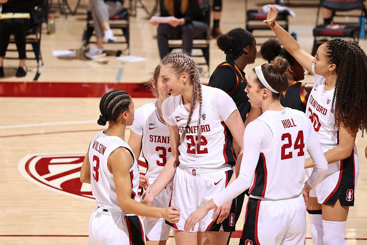 Fresman Cameron Brink (22) celebrates with Anna Wilson, left, and Lacie Hull during Friday's game against Arizona State at Maples Pavilion