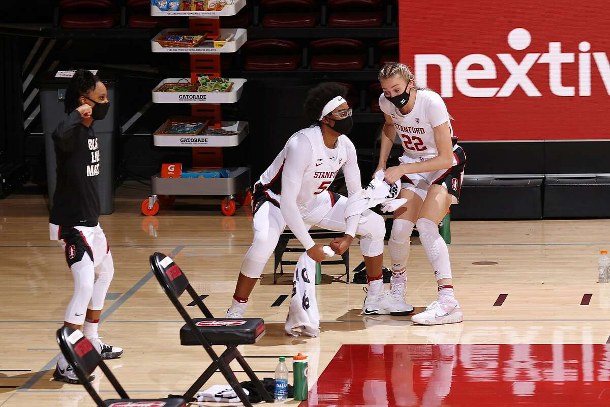 Francesca Belibi (5) and Cameron Brink celebrate from the bench during the Stanford women's basketball team's victory over Arizona State on Friday at Maples Pavilion.