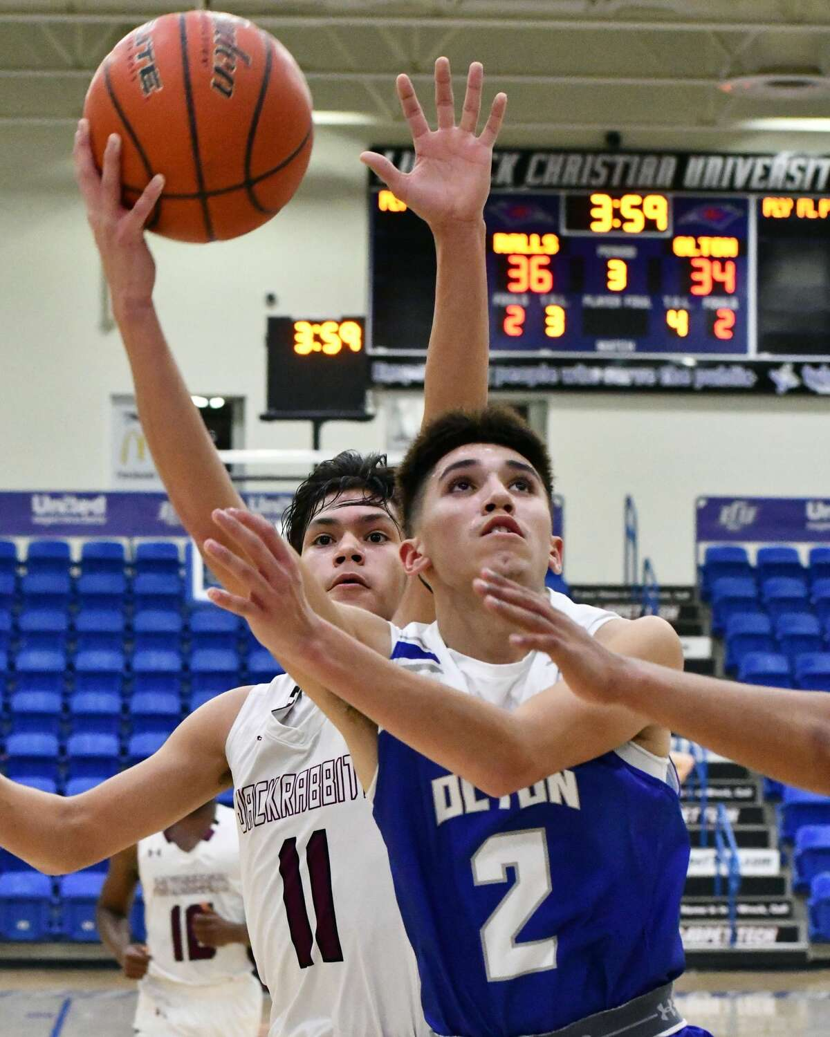 Olton's Jake Soliz puts up the shot attempt against Ralls during their Class 2A bi-district boys basketball playoff game on Friday in the Rip Griffin Center at Lubbock Christian University.