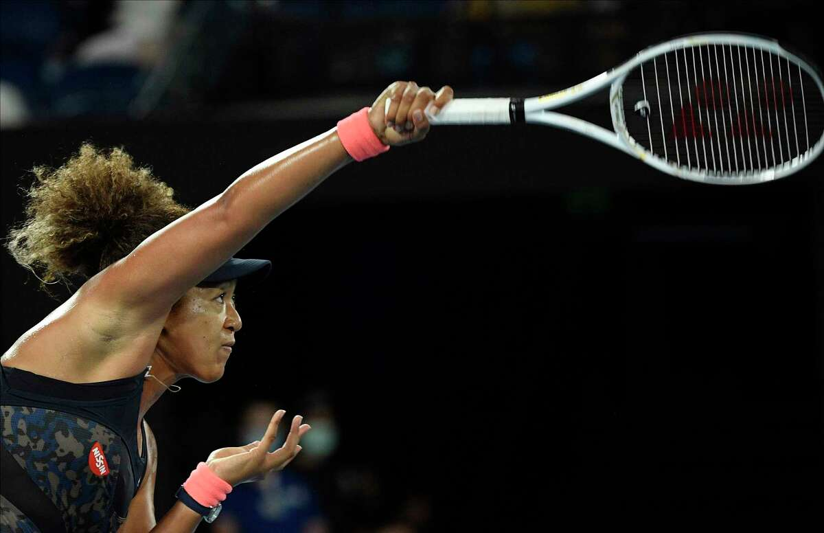 Japan's Naomi Osaka serves to United States' Jennifer Brady during the women's singles final at the Australian Open tennis championship in Melbourne, Australia, Saturday, Feb. 20, 2021.