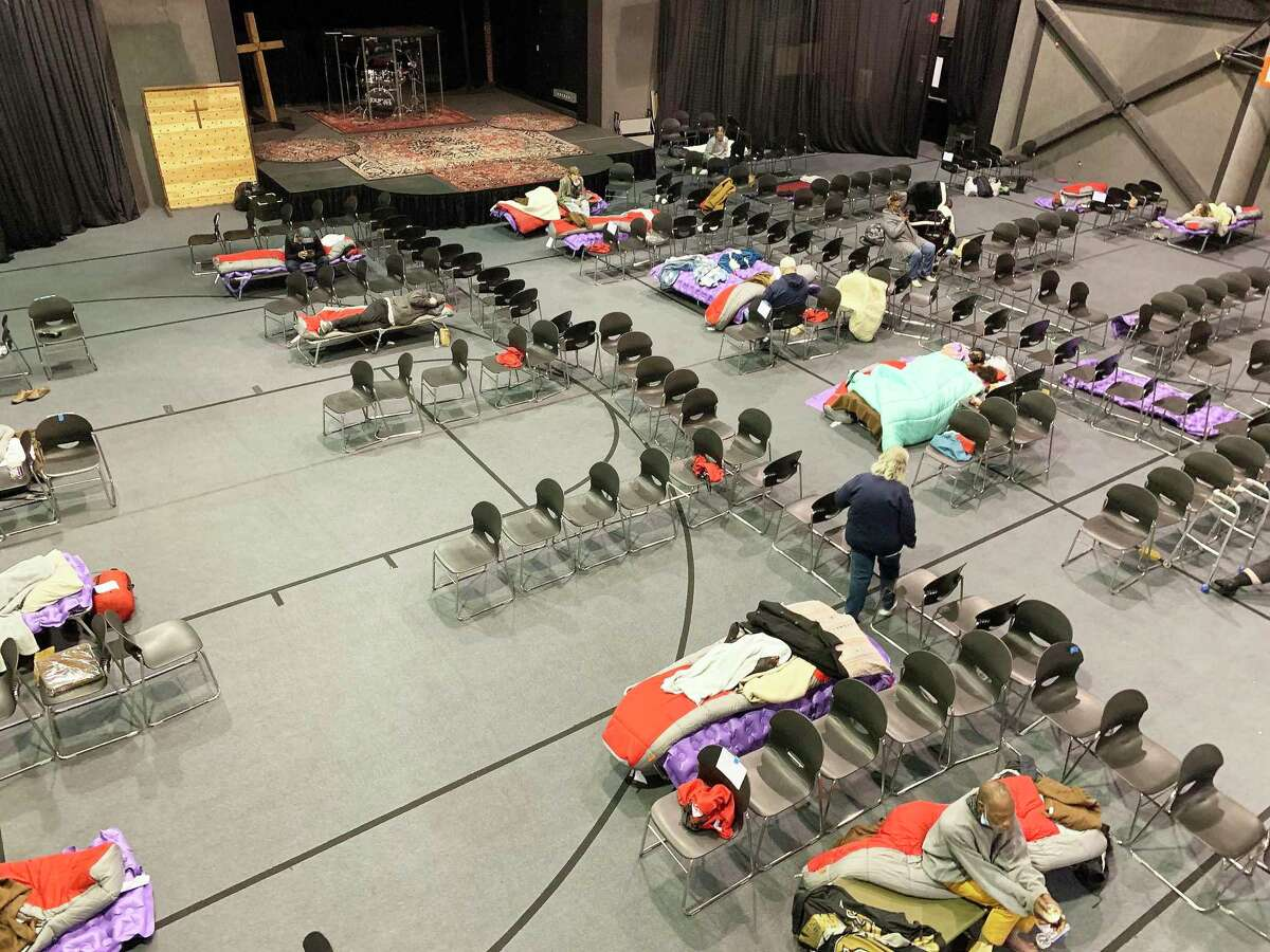 The Foundry United Methodist Church in Jersey Village opened the doors of their gymnasium to the homeless and elderly seeking refuge from the bitter cold weather. The facility quickly reached capacity as temperatures dropped to historic lows.