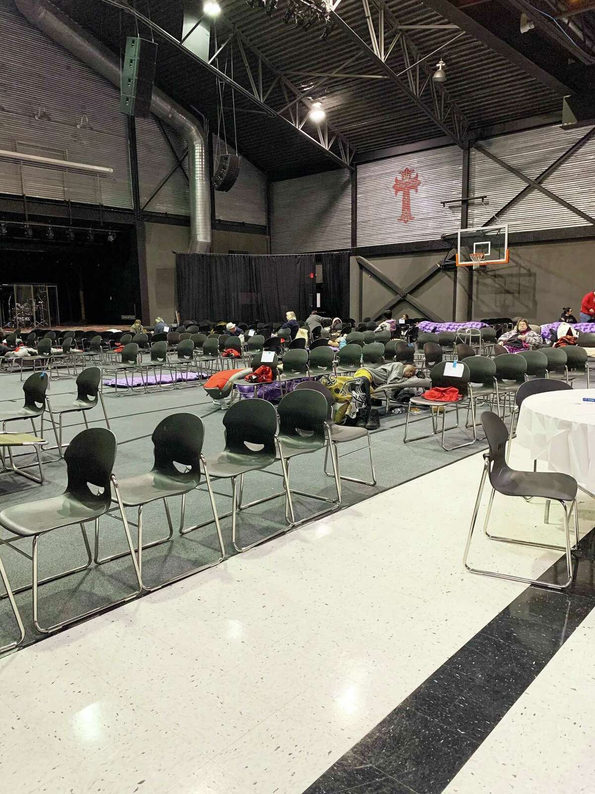 Volunteers used chairs to divide out the gym into 10-foot by 10-foot cubicles for each person or family to maintain social distancing per Covid-19 protocols. As of Friday, many were still hunkered down awaiting warmer temperatures before transitioning back to their normal life.