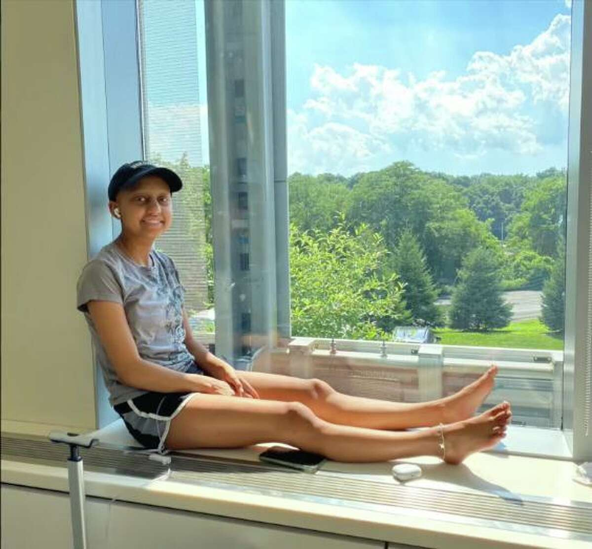 Sonia Kocinsky listens to music during a break from physical therapy.