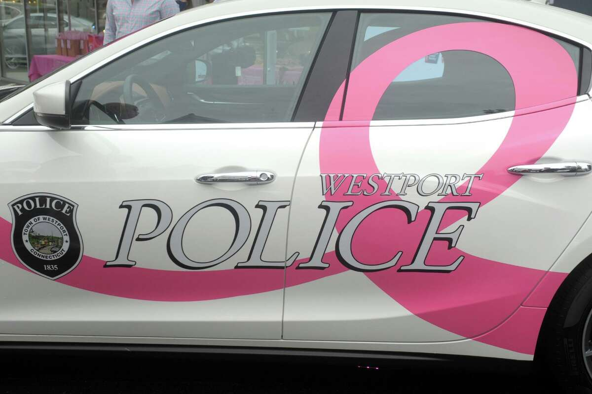 A newly decorated Maserati, promoting breast cancer awareness month, was delivered to the Westport Police Department during a kick-off event at Maserati of Westport, Oct. 2, 2020.