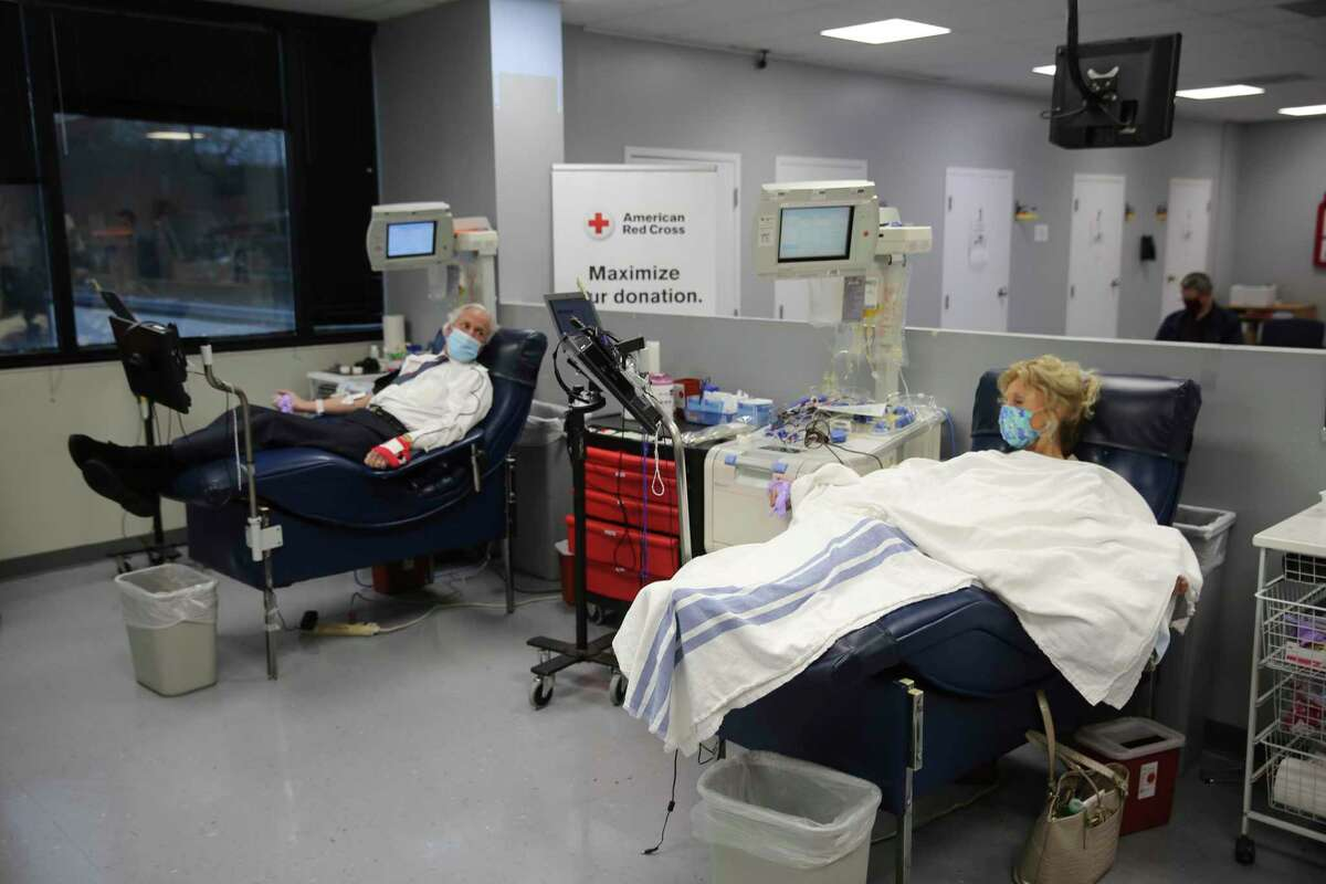 South Carolina Gov. Henry McMaster, left, and first lady Peggy McMaster, right, donate plasma to help with COVID-19 treatment on Friday, Feb. 5, 2021, in Columbia, S.C. The McMasters both contracted COVID-19 in December and said this was their way to help others. (AP Photo/Jeffrey Collins)