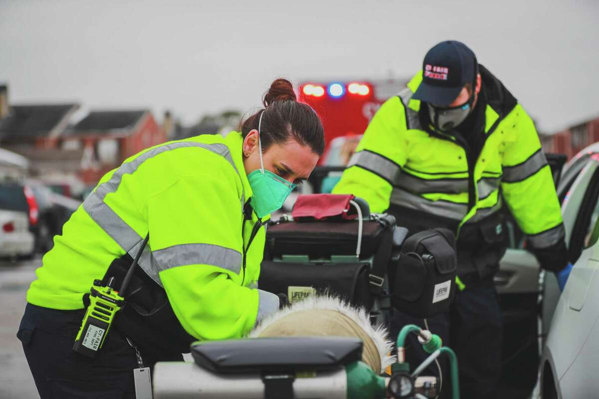 Crews with the Cy-Fair Fire Department help people who need medical attention for carbon monoxide poisoning during the winter storm Tuesday, Feb. 16, 2021.