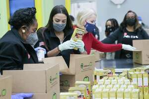 U.S. Rep. Sheila Jackson Lee, from left, volunteers at the Houston Food Bank with U.S. Rep. Alexandria Ocasio-Cortez and U.S. Rep. Sylvia Garcia and on Saturday, Feb. 20, 2021.