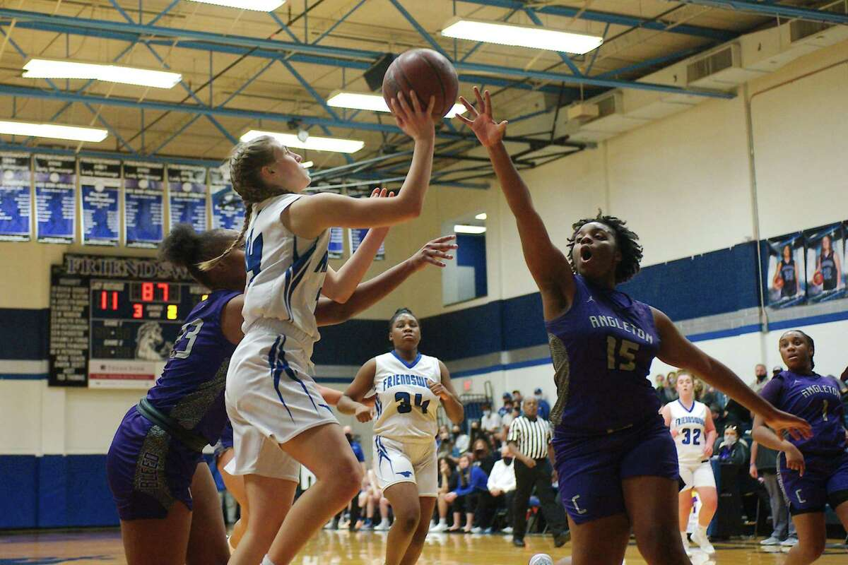 Friendswood's Jocelyn Green (14) drives the baseline against Angleton's K'Mory Price (15) Friday at Friendswood High School.