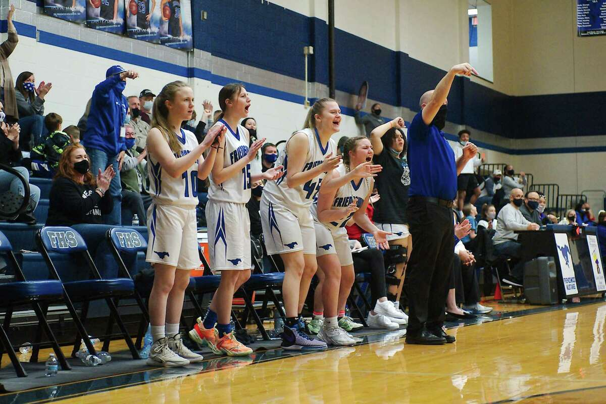 Friendswood players and head coach Daron Scott react to a play on the court against Angleton Friday at Friendswood High School.