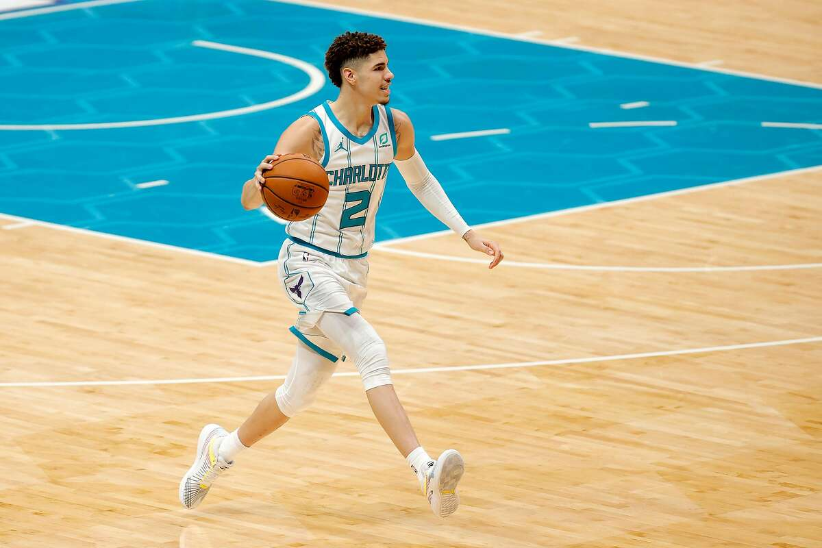 LaMelo Ball #2 of the Charlotte Hornets dribbles during the second half of their game against the Toronto Raptors at Spectrum Center on Dec. 12, 2020 in Charlotte, North Carolina. (Jared C. Tilton/Getty Images/TNS)