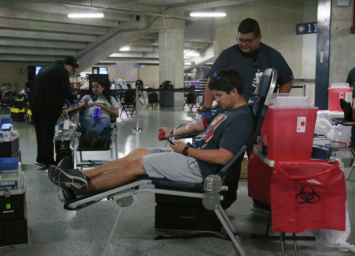 Joseph Treviño, 30, dontes blood as Ernesto Covarrubias helps him at the Alamodome during a 3-day blood drive, Tuesday, March 17, 2020. The South Texas Blood and Tissue Center and the City of San Antonio is holding the event through Thursday between 9 a.m. and 6 p.m. Coronavirus concerns has led to the cancelling of blood drives and low supplies at South Texas hospital necessitating the need for donations. Donors can make their appointment at www.SouthTexasBlood.org/Give-Now or by calling 210-731-5590.
