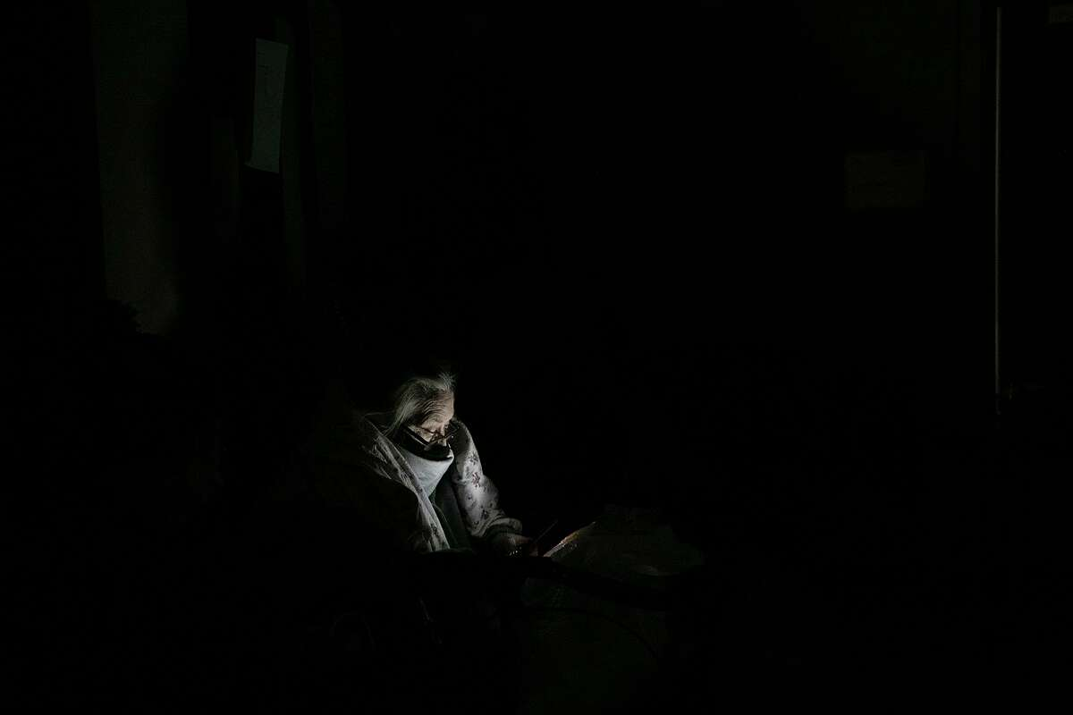 A Fair Avenue Apartments resident waits in a hallway for VIA buses to arrive to transport residents to the Grand Hyatt hotel downtown late Tuesday night after living without water and electricity for days in San Antonio on Feb. 16, 2021.