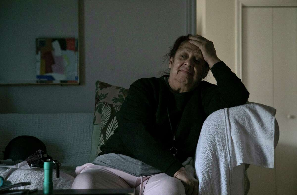 Maria Rodriguez, 79, waits out another electricity outage in her apartment at the Ernest C. Olivares Senior Community Residence in San Antonio on Feb. 17, 2021. She estimates the residence has had twenty hours of electricity total since Sunday.