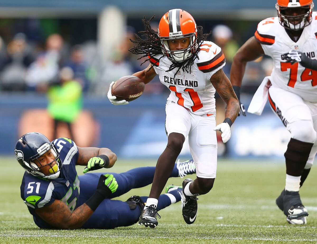 Travis Benjamin evades a tackle attempt while with the Browns in 2015.