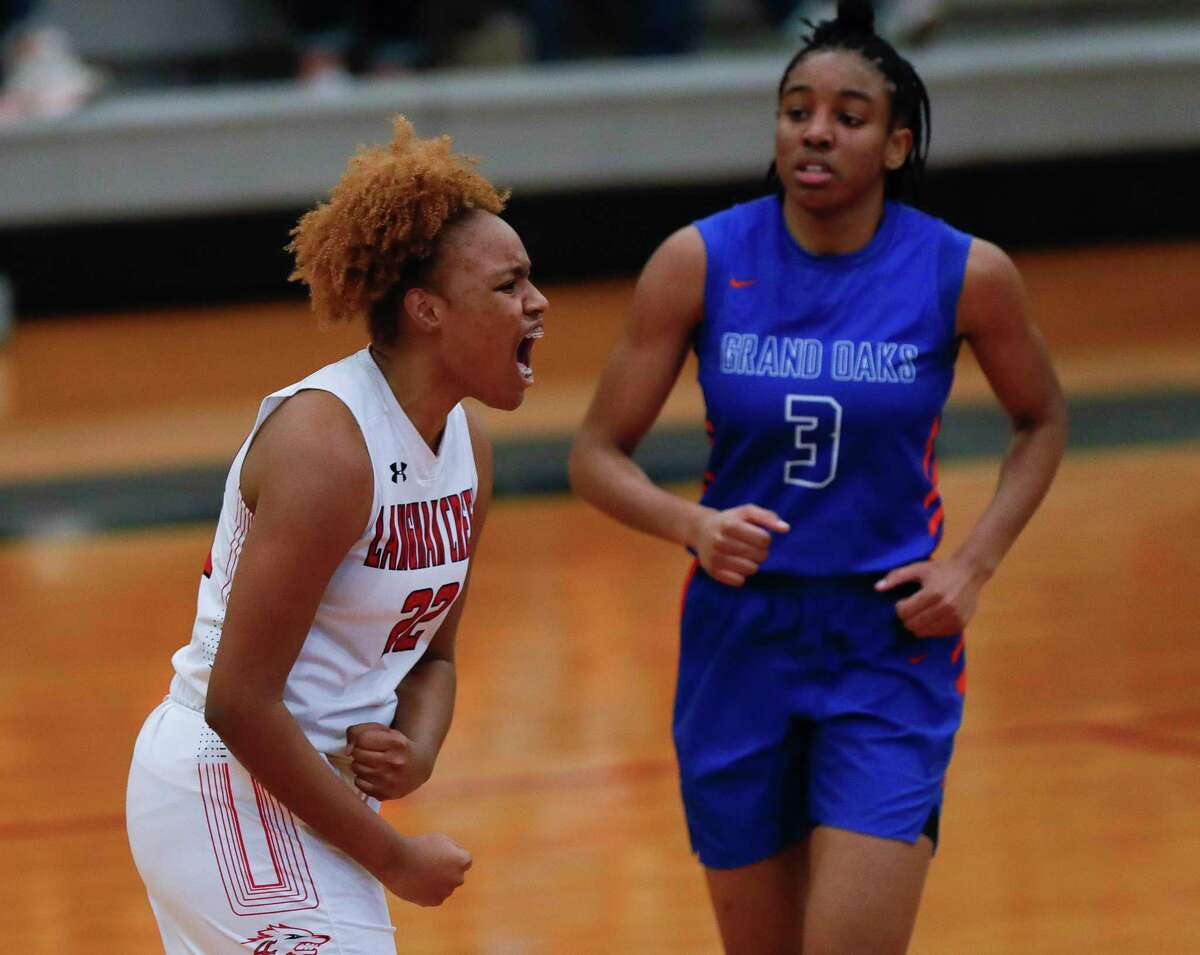 Langham Creek forward Saija Cleveland (22) reacts in front of Grand Oaks center Ngozi Agoh (3) as a timeout is called during the third quarter of a Region II-6A area girls basketball playoff game at Klein Collins High School, Saturday, Feb. 20, 2021, in Spring.