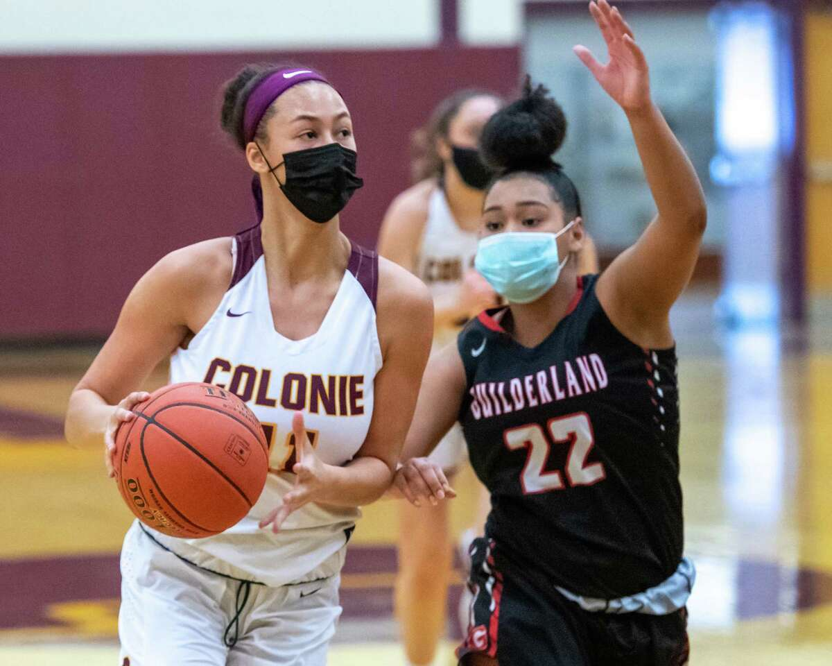 Colonie forward Jayla Tyler drives to the basket in front of Guilderland sophomore Destiny Pipino during a Suburban Council matchup against Colonie at Colonie High School in Colonie, NY, on Saturday, Feb. 20, 2021 (Jim Franco/special to the Times Union.)