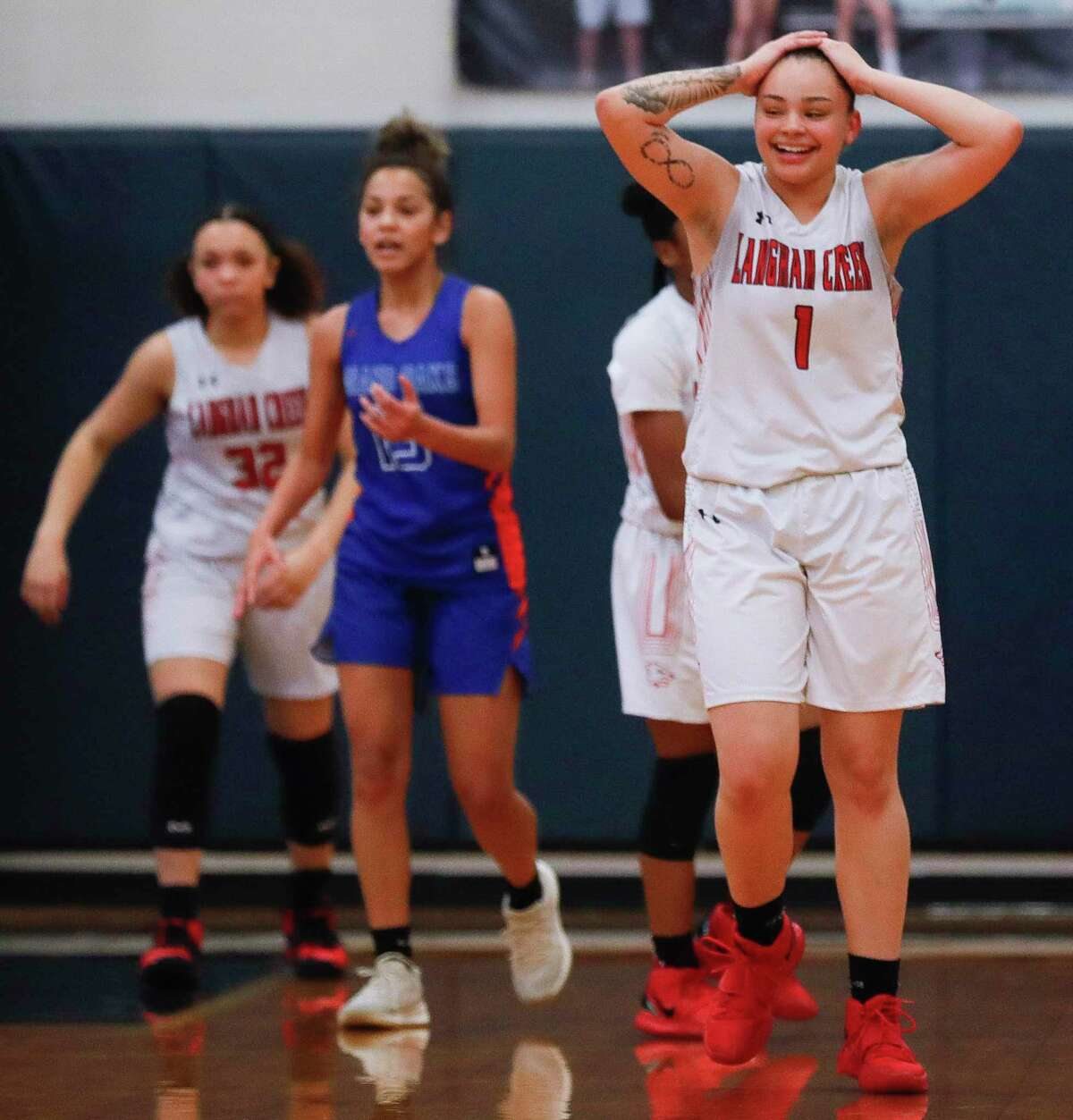 Langham Creek guard Brooklyn Hosford (1) reacts after a turnover call during the first quarter of a Region II-6A area girls basketball playoff game at Klein Collins High School, Saturday, Feb. 20, 2021, in Spring.