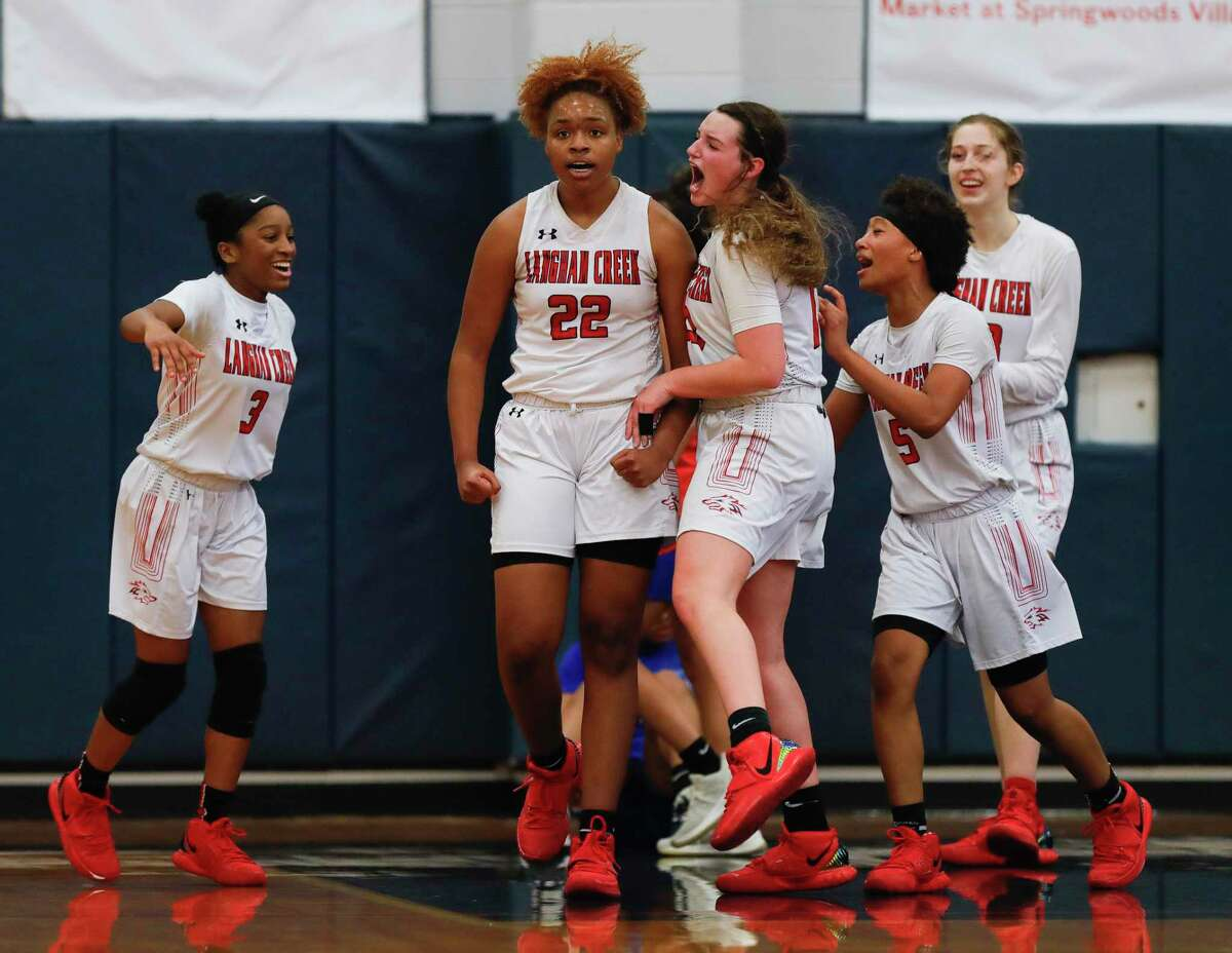 Langham Creek guard Peyton Foster (13) reacts beisde forward Saija Cleveland (22) after making a basket and drawing a foul during the third quarter of a Region II-6A area girls basketball playoff game at Klein Collins High School, Saturday, Feb. 20, 2021, in Spring.