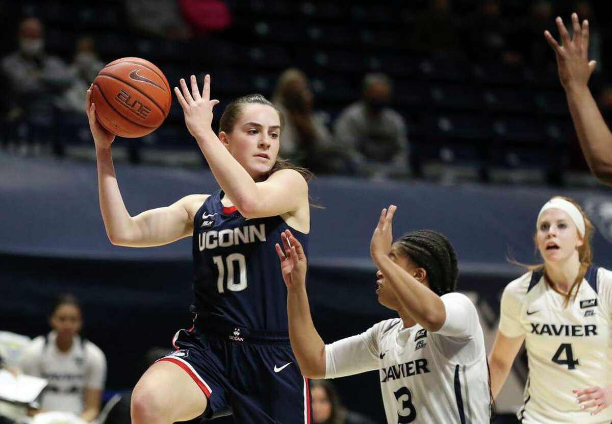 UConn guard Nika Muhl (10) looks to pass over Xavier guard Aaliyah Dunham (3) during the first half on Saturday.