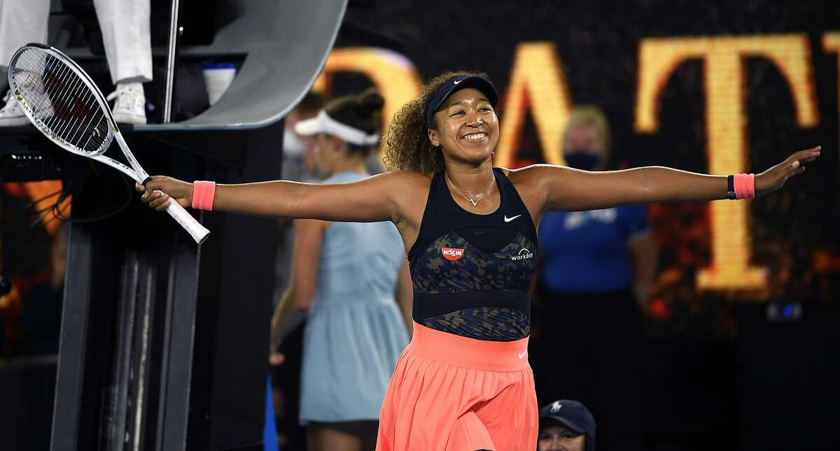 Japan's Naomi Osaka celebrates after defeating American Jennifer Brady in the women's singles final at the Australian Open in Melbourne. Osaka defeated Brady 6-4, 6-3 to win her fourth major title; Brady was appearing in her first major final.