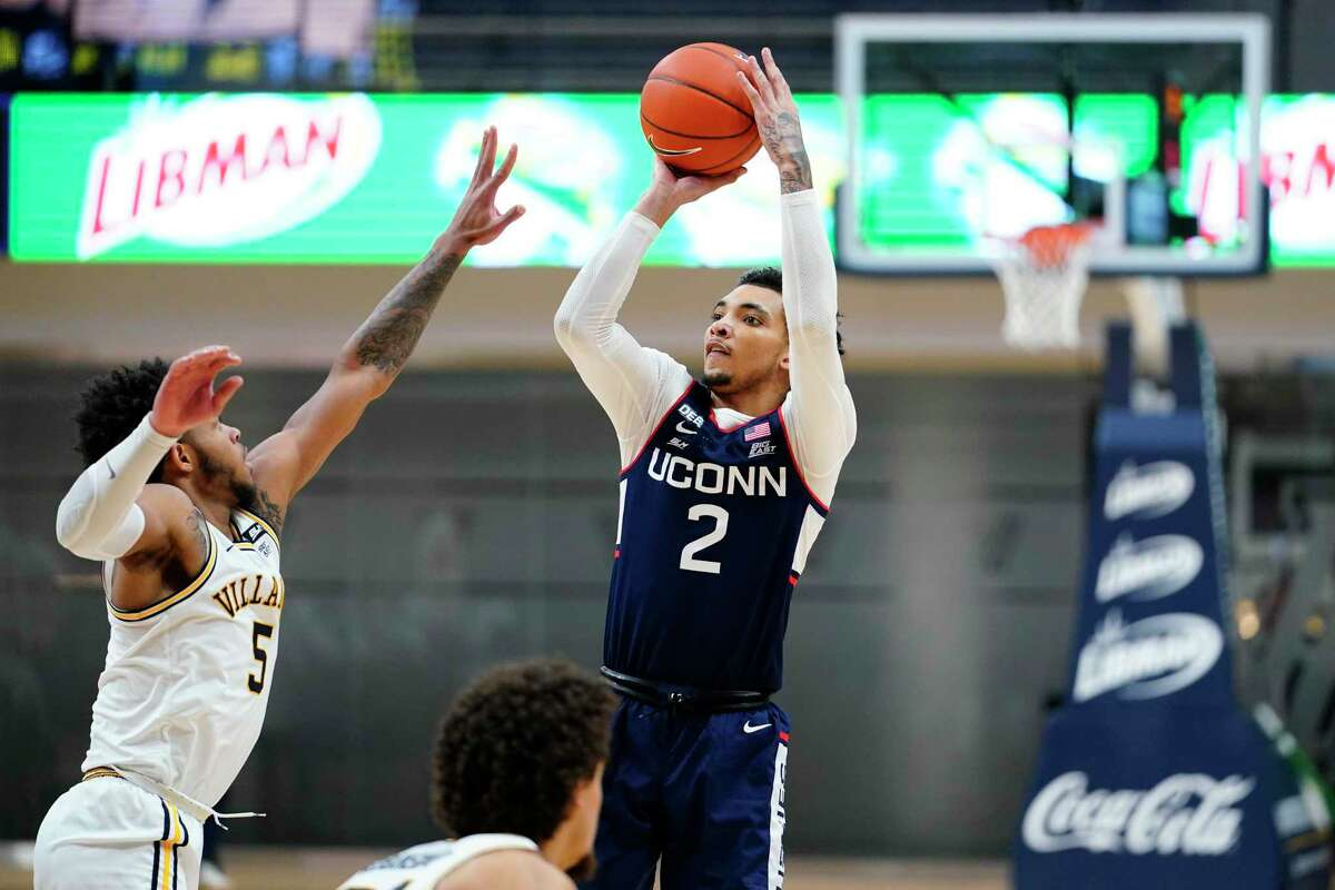 UConn's James Bouknight (2) goes up for a shot against Villanova's Justin Moore during the second half on Saturday.