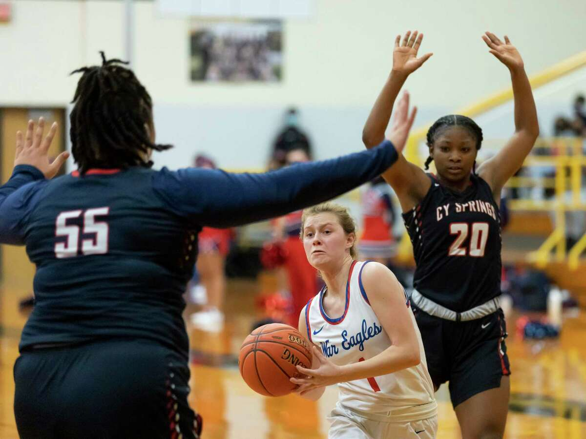 Oak Ridge point guard Nicole Petrakovitz (1) shoots for the basket while blocked off by Cypress Springs center Sian Phipps (55) during the fourth quarter of a Region II-6A area round girls basketball game at Klein Oak High School, Saturday, Feb. 20, 2021 in Spring.