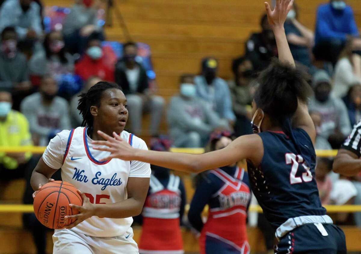 Oak Ridge forward Allison Owens (35) looks for an opening to pass the ball passed Cypress Springs power forward Aniah Wade (23) during the first quarter of a Region II-6A area round girls basketball game at Klein Oak High School, Saturday, Feb. 20, 2021 in Spring.