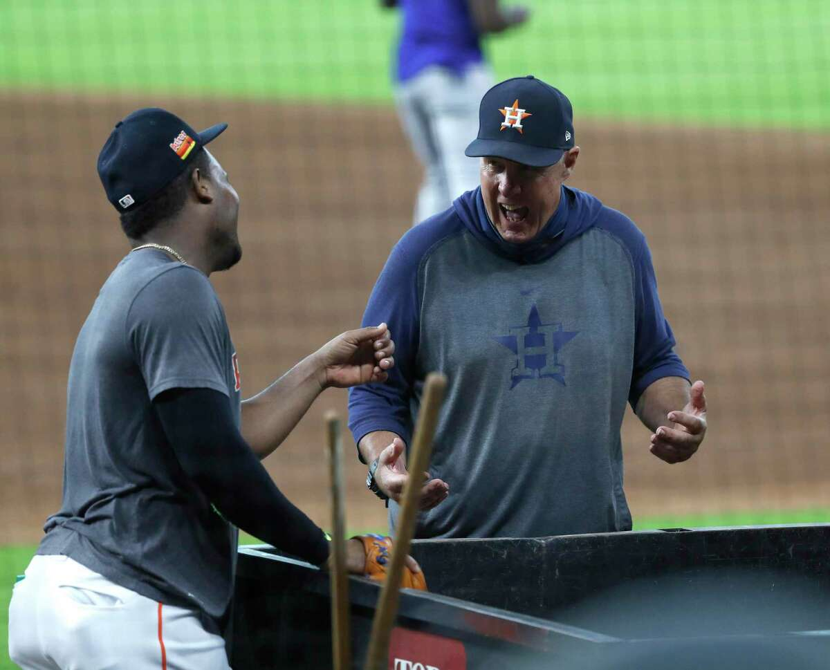 Astros pitching coach Brent Strom chats with pitcher Framber Valdez during batting practice before the start of a game at Minute Maid Park on Sept. 16, 2020.