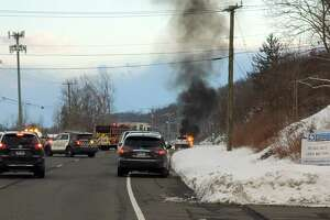 Police and fire units were called to a fully-involved car fire on Route 7 near the Danbury-Ridgefield border Saturday. One person was taken to the hospital, according to dispatch reports.