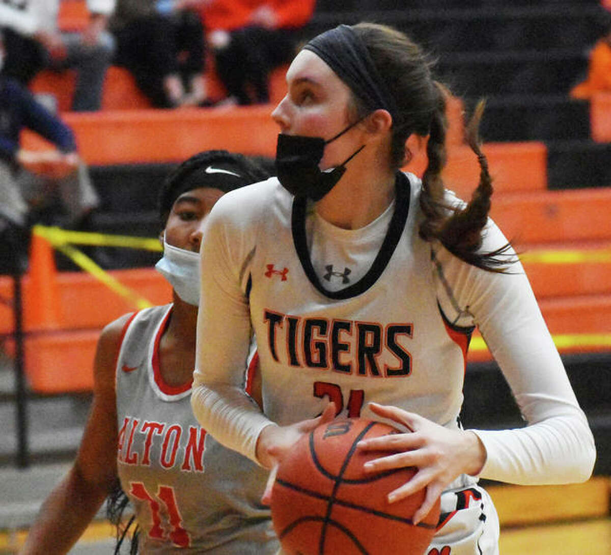 Edwardsville's Elle Evans takes the ball to the basket after stealing the ball at midcourt during the second half of Saturday's game against Alton in Edwardsville.