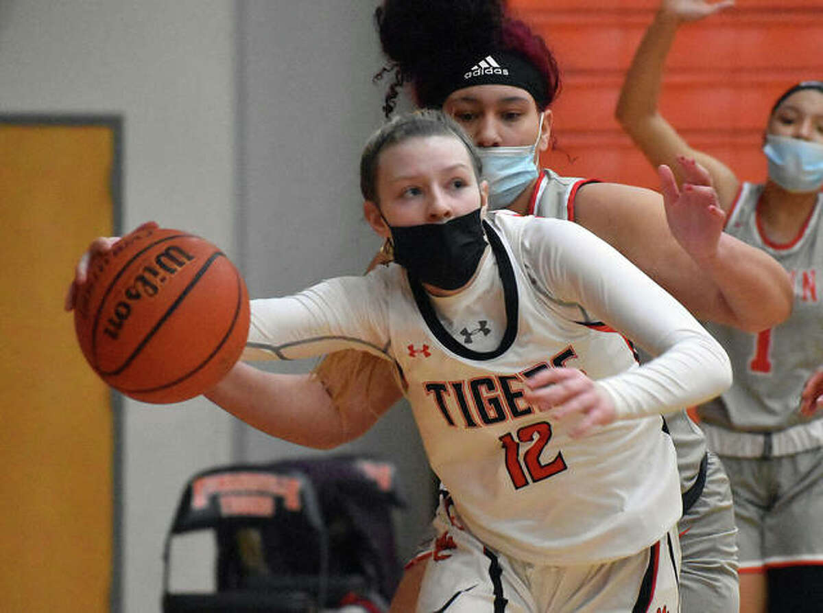Edwardsville's Ella Cook looks to complete a reverse layup while tight roping the baseline during the second quarter against Alton.