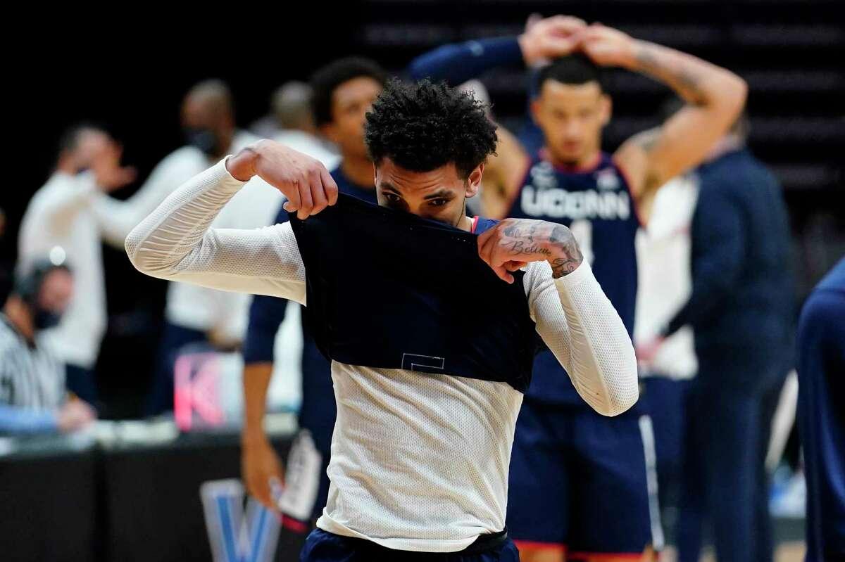 Connecticut's James Bouknight, left, and Tyrese Martin react after an NCAA college basketball game against Villanova, Saturday, Feb. 20, 2021, in Villanova, Pa. (AP Photo/Matt Slocum)