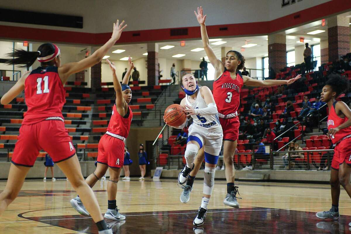 Clear Springs' Kylie Minter (5) tries to lay up a shot past Atascocita's Kori Fenner (3) Saturday, Feb. 20 at La Porte High School.