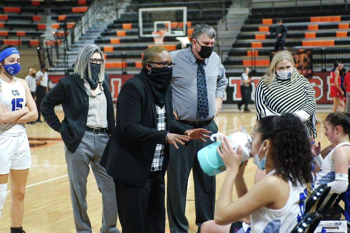 Clear Springs basketball coach Pamela Crawford speaks to her team during a break against Atascocita Saturday at La Porte High School.
