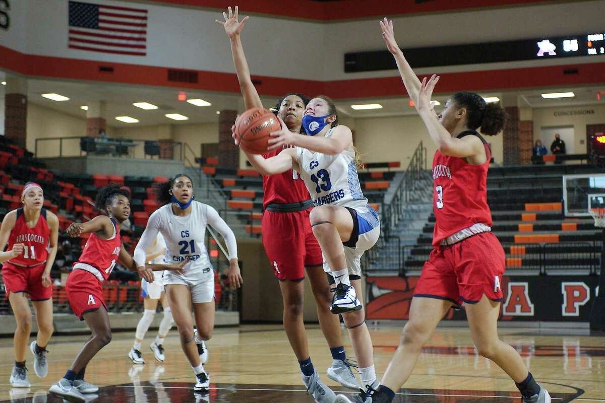Clear Springs' Kenna Gibson (13) lays up a shot past Atascocita's Robin Whitehead (10) and Atascocita's Kori Fenner (3) Saturday, Feb. 20 at La Porte High School.