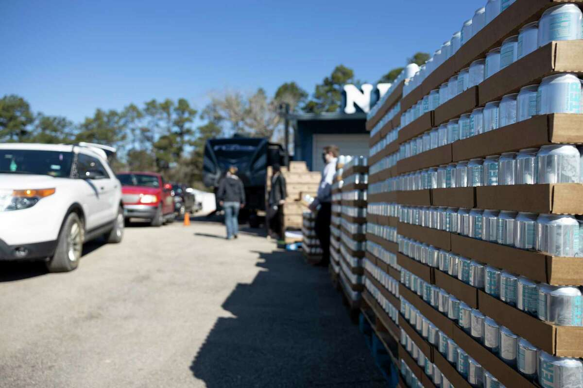 Canned water is stacked during a distribution event held at Nelson Pool, Saturday, Feb. 20, 2021, in Splendora. The Dream Center partnered with Montgomery County and the Houston Food Bank to distribute fresh water and food to locals after an arctic storm caused widespread water insecurity in the state of Texas.