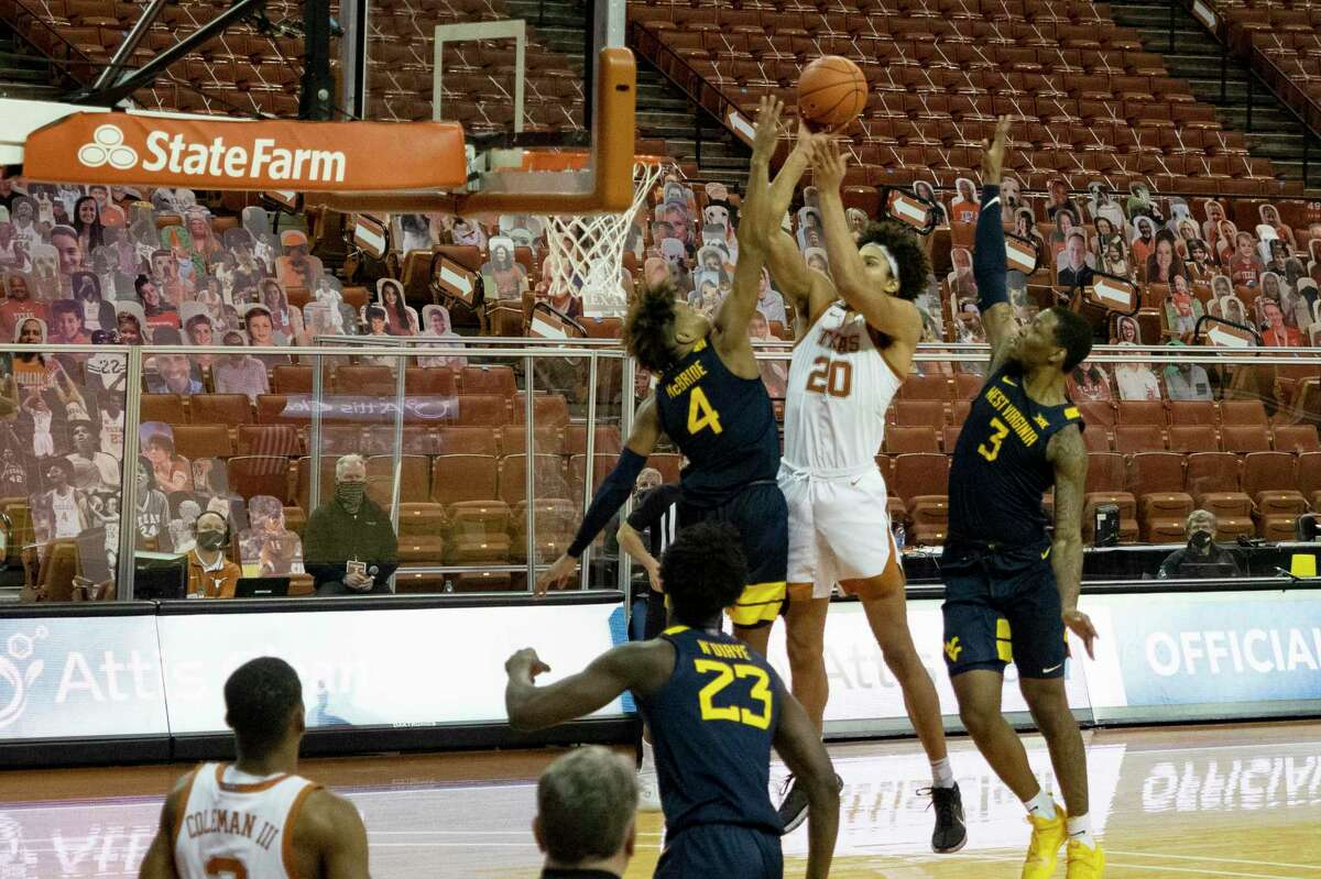Texas forward Jericho Sims attempts a buzzer-beater shot to tie the game in Saturday's loss to West Virginia on Saturday at the Erwin Center. The Mountaineers rallied from a 19-point deficit.
