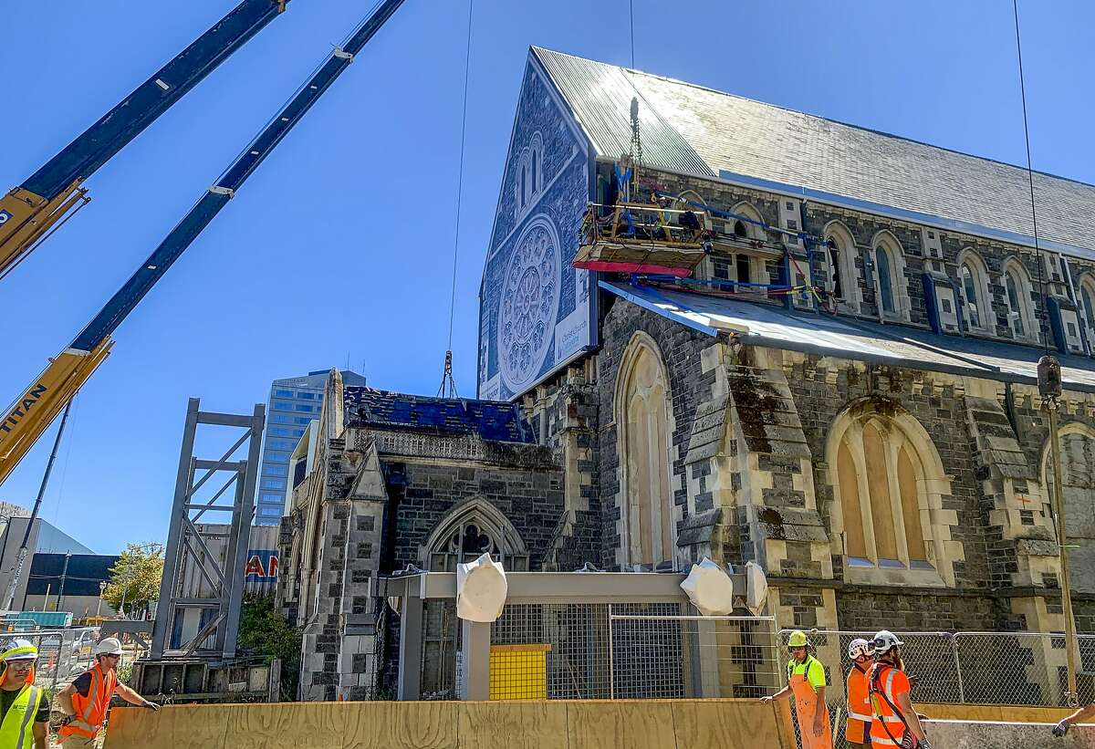 Construction staff work on the 2011 earthquake damaged Christ Church Cathedral in central Christchurch, New Zealand, on Feb. 11, 2021. The Christ Church Cathedral was arguably New Zealand's most iconic building before much of it crumbled during an earthquake 10 years ago. The years of debate that followed over whether the ruins should be rebuilt or demolished came to symbolize the paralysis that has sometimes afflicted the broader rebuild of Christchurch. But as the city on Monday, Feb. 22 marks one decade since the quake struck, killing 185 people and upending countless more lives, there are finally signs of progress on the cathedral. It's being rebuilt to look much like the original that was finished in 1904, only with modern-day improvements to make it warmer and safer. (AP Photo/Nick Perry)