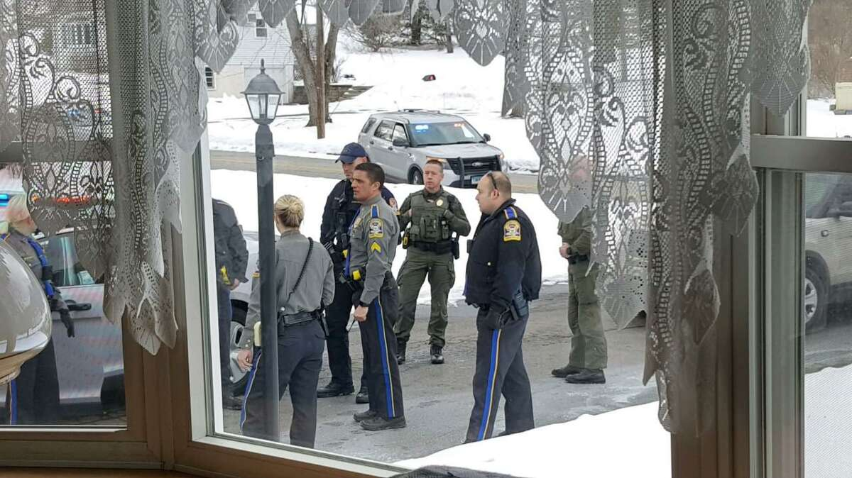 TOLLAND, Conn. - Resident Lance Shackway captured these photos as state police took several suspects into custody during an incident around 3 p.m. Saturday, Feb. 20. State police said a Trooper was hospitalized after a cruiser was intentionally struck by one of the suspects.