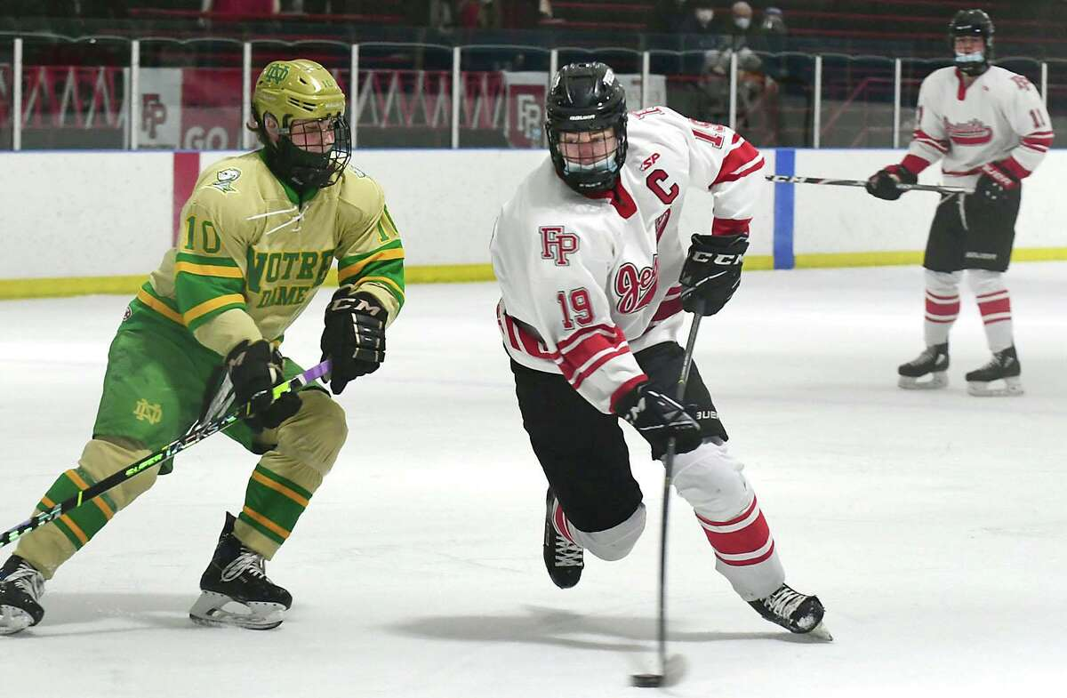 Notre Dame-West Haven's John D'Errico, left, defends against Fairfield Prep's Mason Whitney during Saturday's game at Winterland Ice Rink in Bridgeport. The third-ranked Jesuits beat the top-ranked Green Knights 4-2. Get a full recap at GameTimeCT.com.