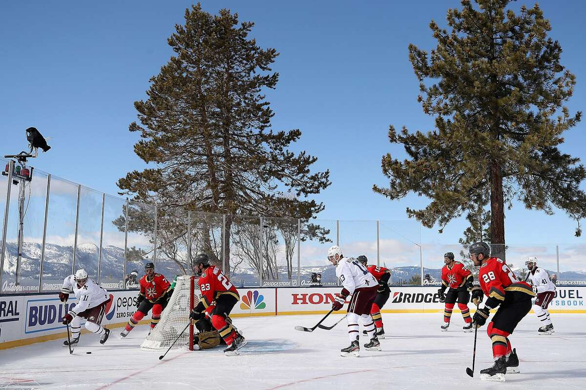 Matt Calvert (#11) of the Colorado Avalanche skates with the puck during the first period of an outdoor game Saturday against the Vegas Golden Knights at the Edgewood Tahoe Resort in Stateline, Nevada. The game, a unique NHL event, was suspended due to poor ice conditions, with play scheduled to resume later Saturday night.