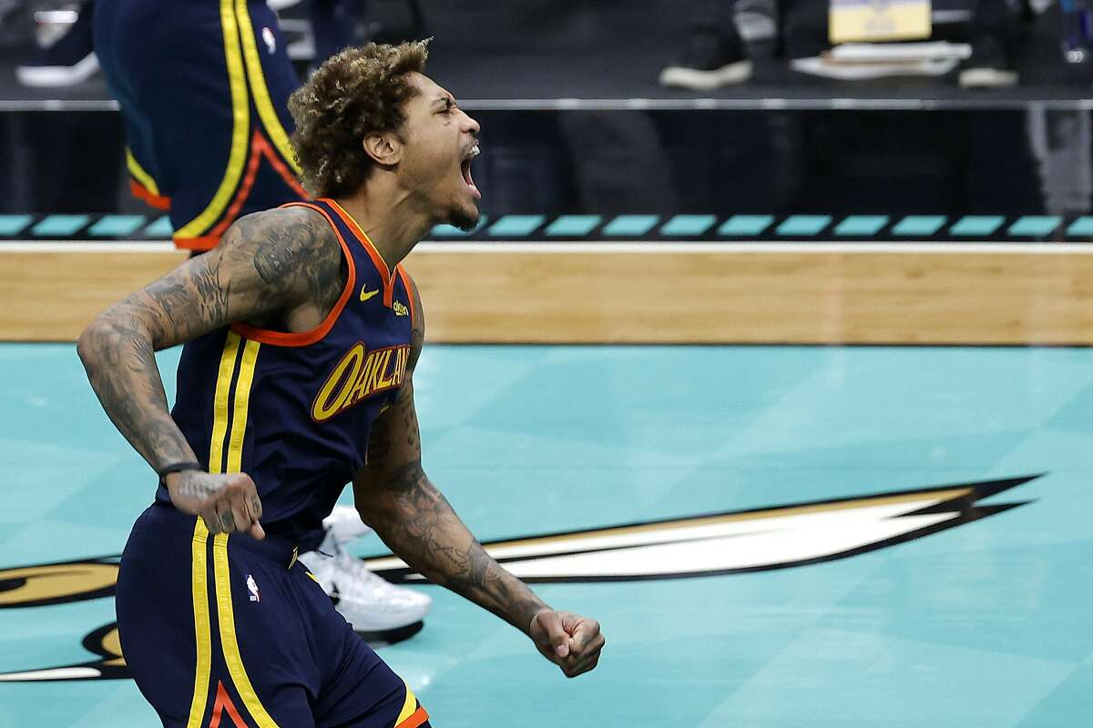 CHARLOTTE, NORTH CAROLINA - FEBRUARY 20: Kelly Oubre Jr. #12 of the Golden State Warriors reacts following a dunk during the second quarter of their game against the Charlotte Hornets at Spectrum Center on February 20, 2021 in Charlotte, North Carolina. NOTE TO USER: User expressly acknowledges and agrees that, by downloading and or using this photograph, User is consenting to the terms and conditions of the Getty Images License Agreement. (Photo by Jared C. Tilton/Getty Images)