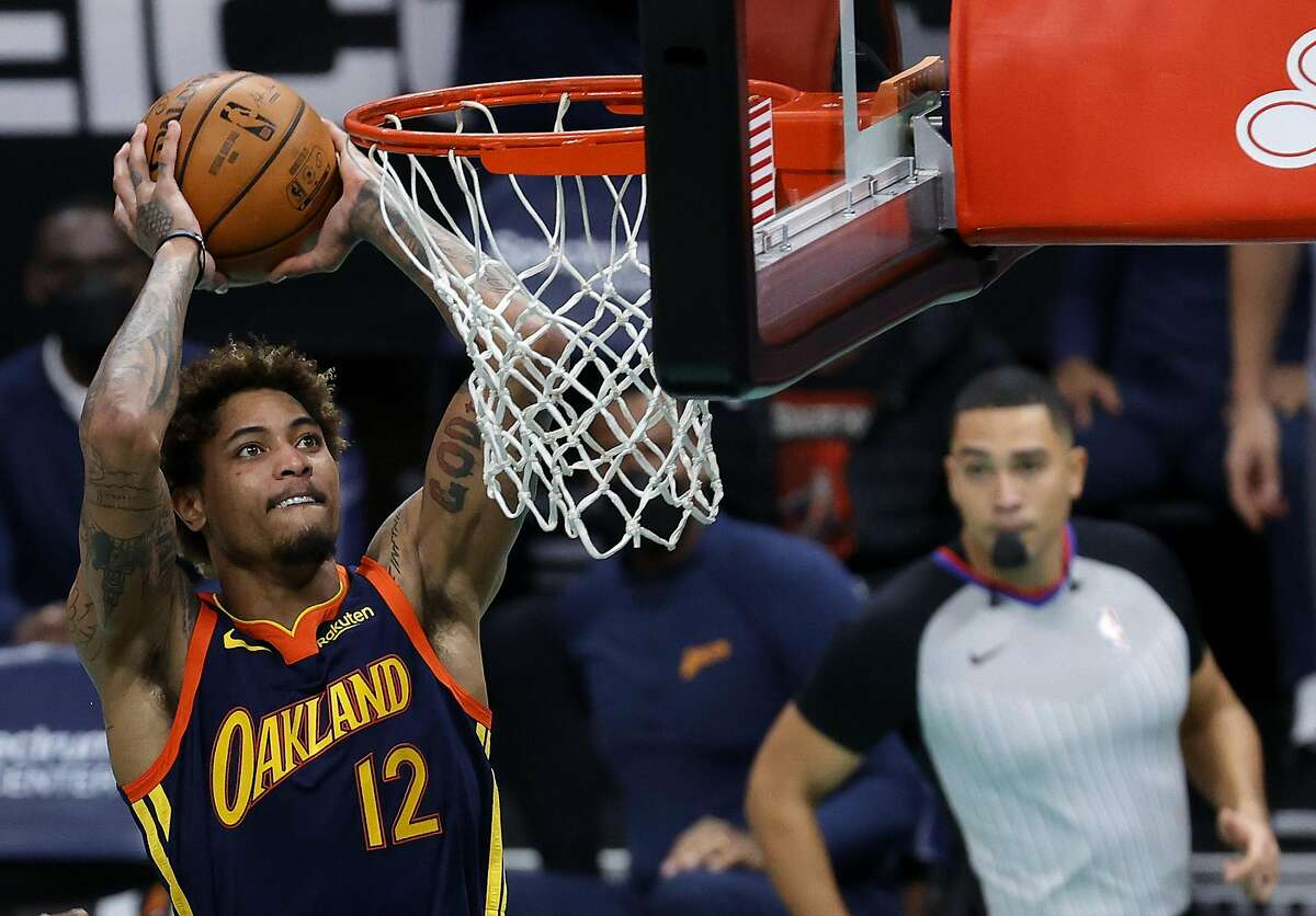 CHARLOTTE, NORTH CAROLINA - FEBRUARY 20: Kelly Oubre Jr. #12 of the Golden State Warriors dunks the ball during the second quarter of their game against the Charlotte Hornets at Spectrum Center on February 20, 2021 in Charlotte, North Carolina. NOTE TO USER: User expressly acknowledges and agrees that, by downloading and or using this photograph, User is consenting to the terms and conditions of the Getty Images License Agreement. (Photo by Jared C. Tilton/Getty Images)