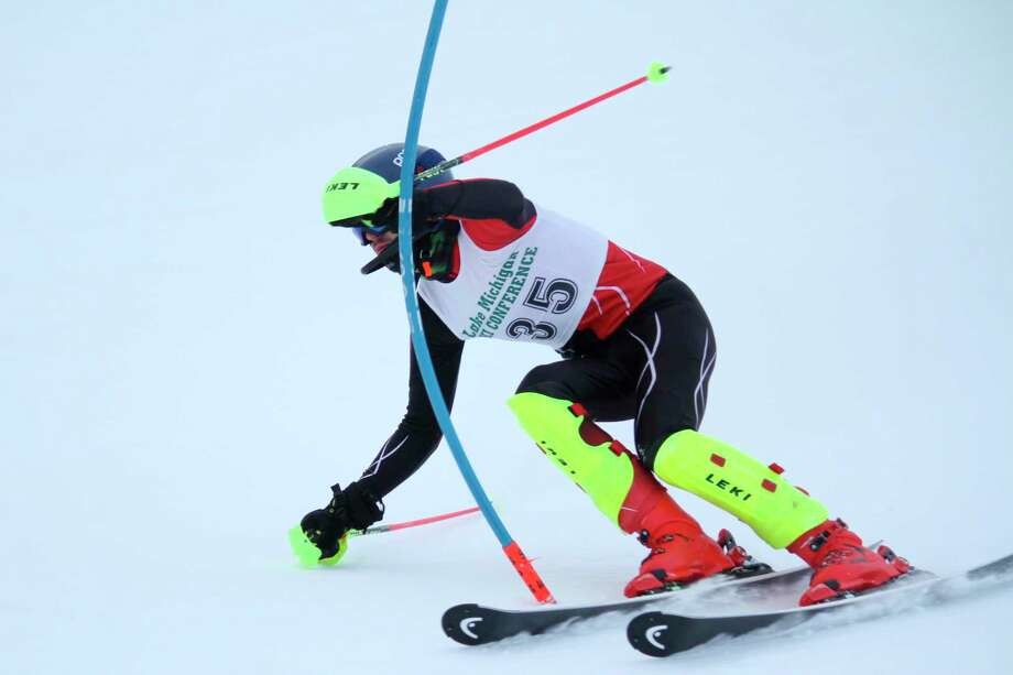 Quincy Thayer ends his skiing career with a three-peat as conference champion on Feb. 17. (Robert Myers/Record Patriot)