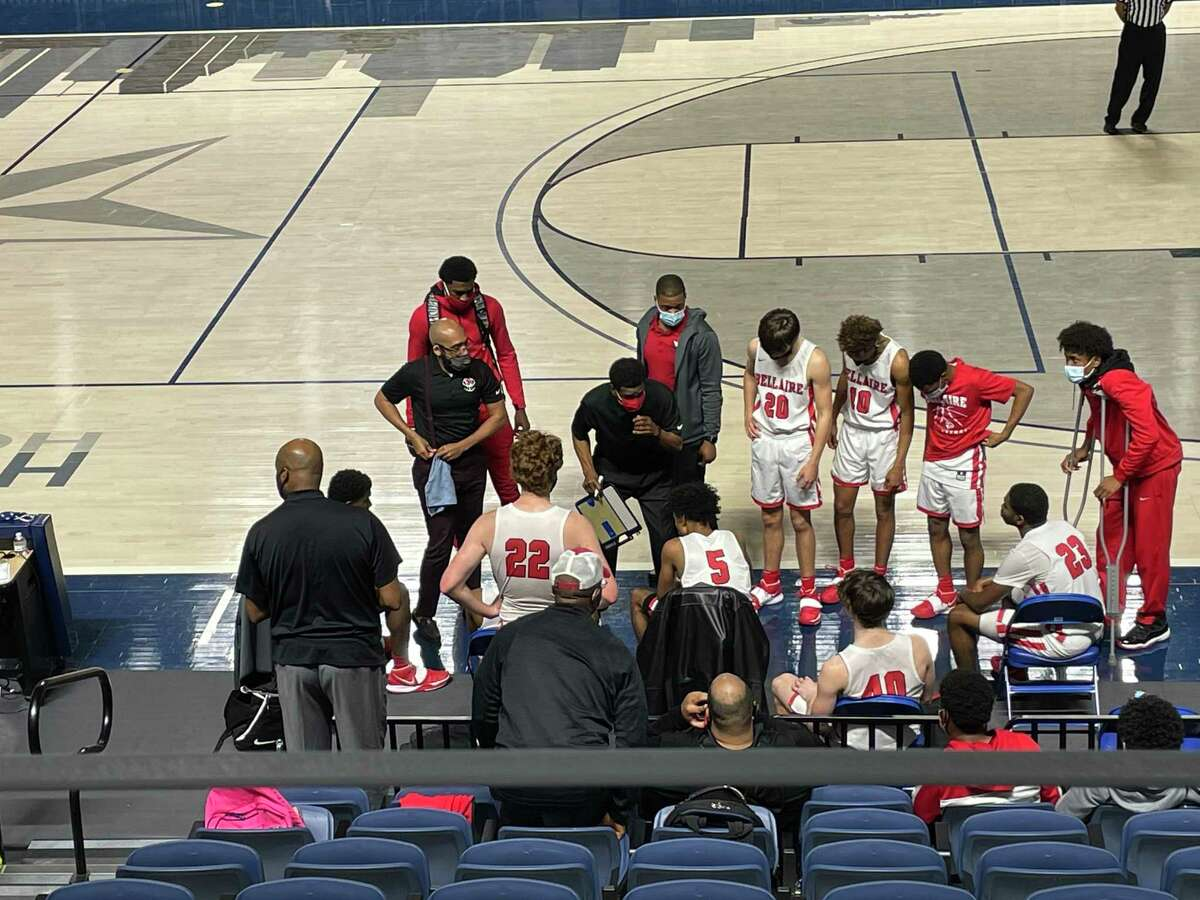 Bellaire coach Bruce Glover talks to the team during a timeout in the fourth quarter of its opening round playoff game against Stratford at Delmar Fieldhouse on Feb. 20