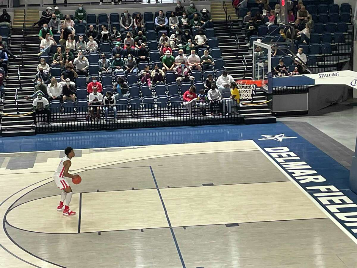 Bellaire's Elijah Lawrence shoots a technical free throw in the fourth quarter of the Cardinals' opening round playoff game against Stratford at Delmar Fieldhouse on Feb. 20