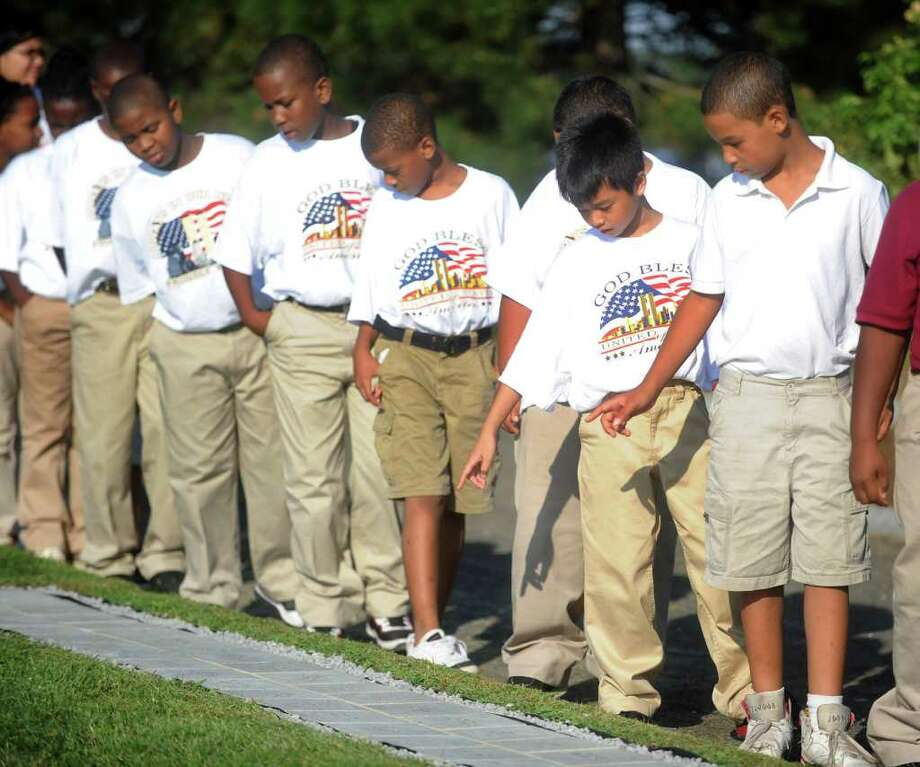 Classical Studies Academy fifth grade students walk around the September 11 memorial at Sherwood Island State Park before the service Tuesday, September 7, 2010. Photo: Lindsay Niegelberg / Connecticut Post