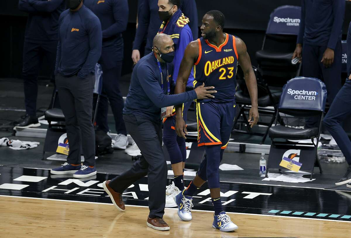 Draymond Green is escorted off the court following his second technical foul in the final seconds Saturday in Charlotte.
