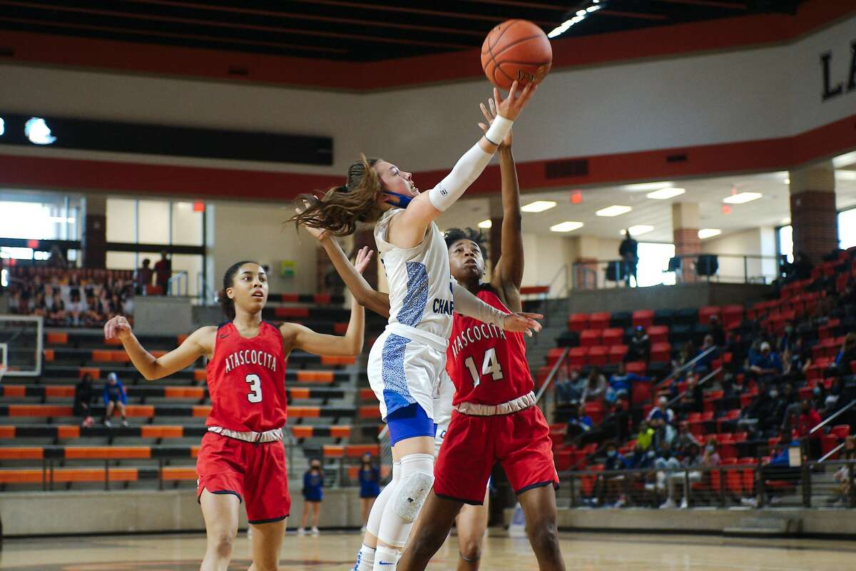 Clear Springs' Kylie Minter (5) tries toput up a shot over Tamya Tennant (14) Saturday, Feb. 20 at La Porte High School.